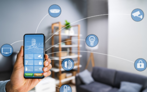 Man holding a mobile phone looking at his smart home dashboard